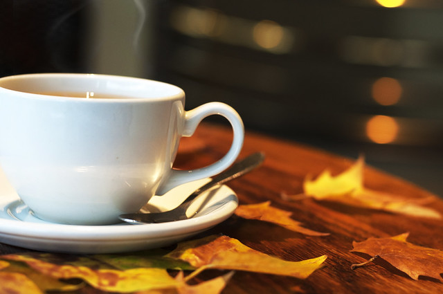 Hot, steaming cup of tea in cosy cafe in the Autumn