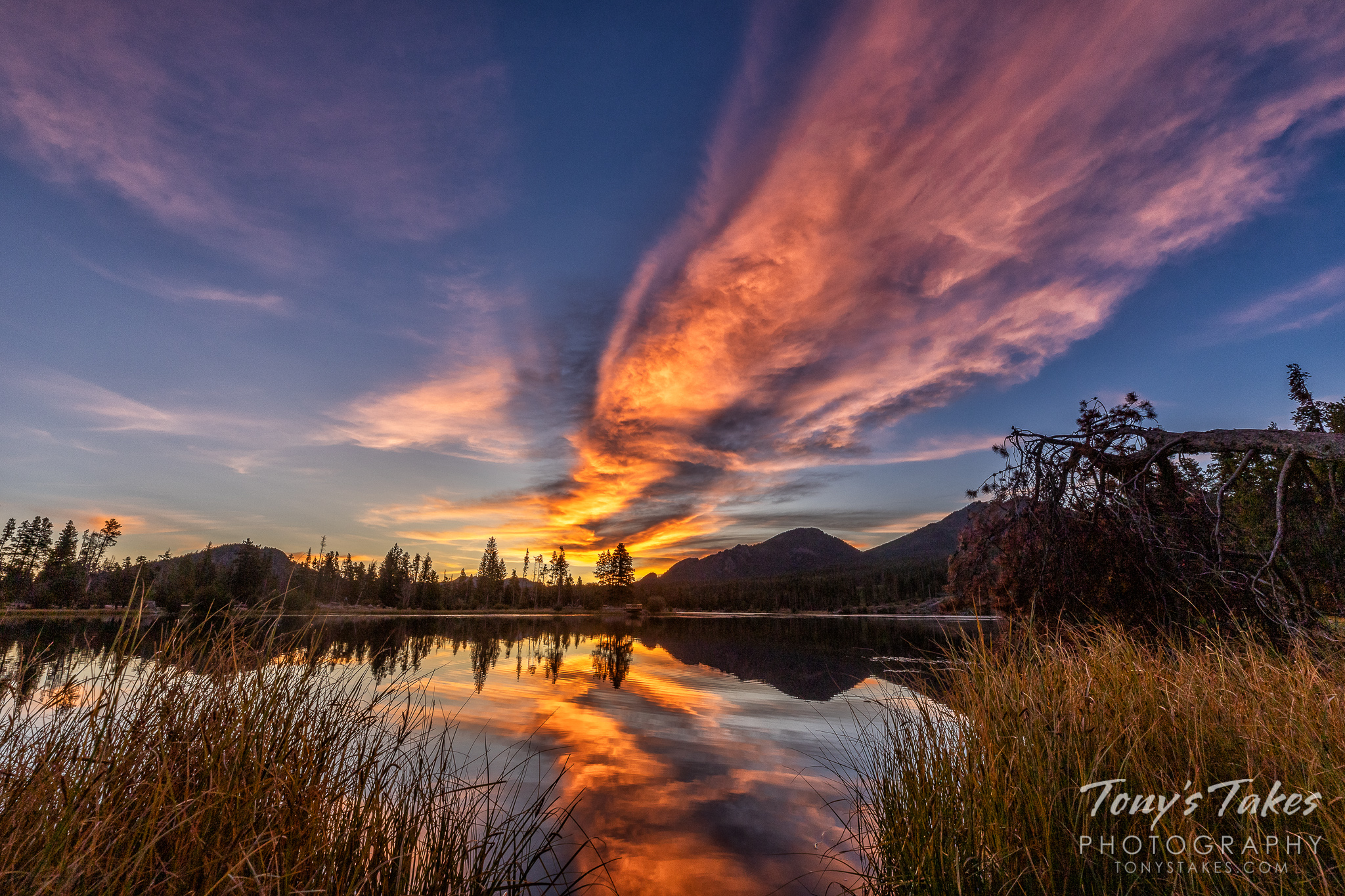 A beautiful sunrise with reflections on Sprague Lake in Rocky Mountain National Park. (© Tony's Takes)
