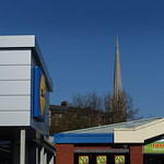 Church spire by the shops