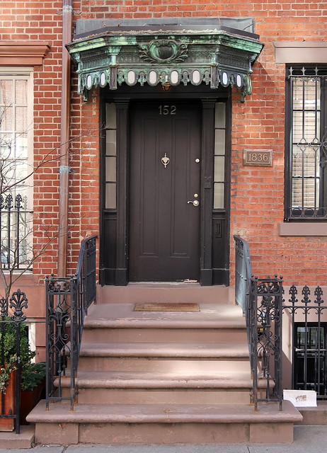 The front door, with a copper and glass awning, 152 West 11th Street (1836), Greenwich Village, New York