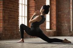 Young woman doing anjaneyasana exercise
