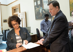 "Rep. John Frey looks on as Lourdes Montalvo, dir. of constituent services for the Secretary of the State's Office,checks to make sure each of the 54 House Republican petitions calling for a special session is properly signed.   Republicans want a special session to eliminate the recently passed, and soon-to-be-enacted, ""grocery tax"" passed in the state budget."