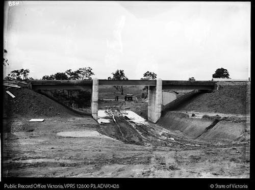 Looking north from Windsor Avenue and Glen Alvie Estate at Alvie Road railway bridge with Alvie Road under construction, circa 1929
