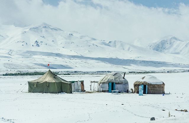 Yurts and tent in Suusamyr Valley, Kyrgyzstan