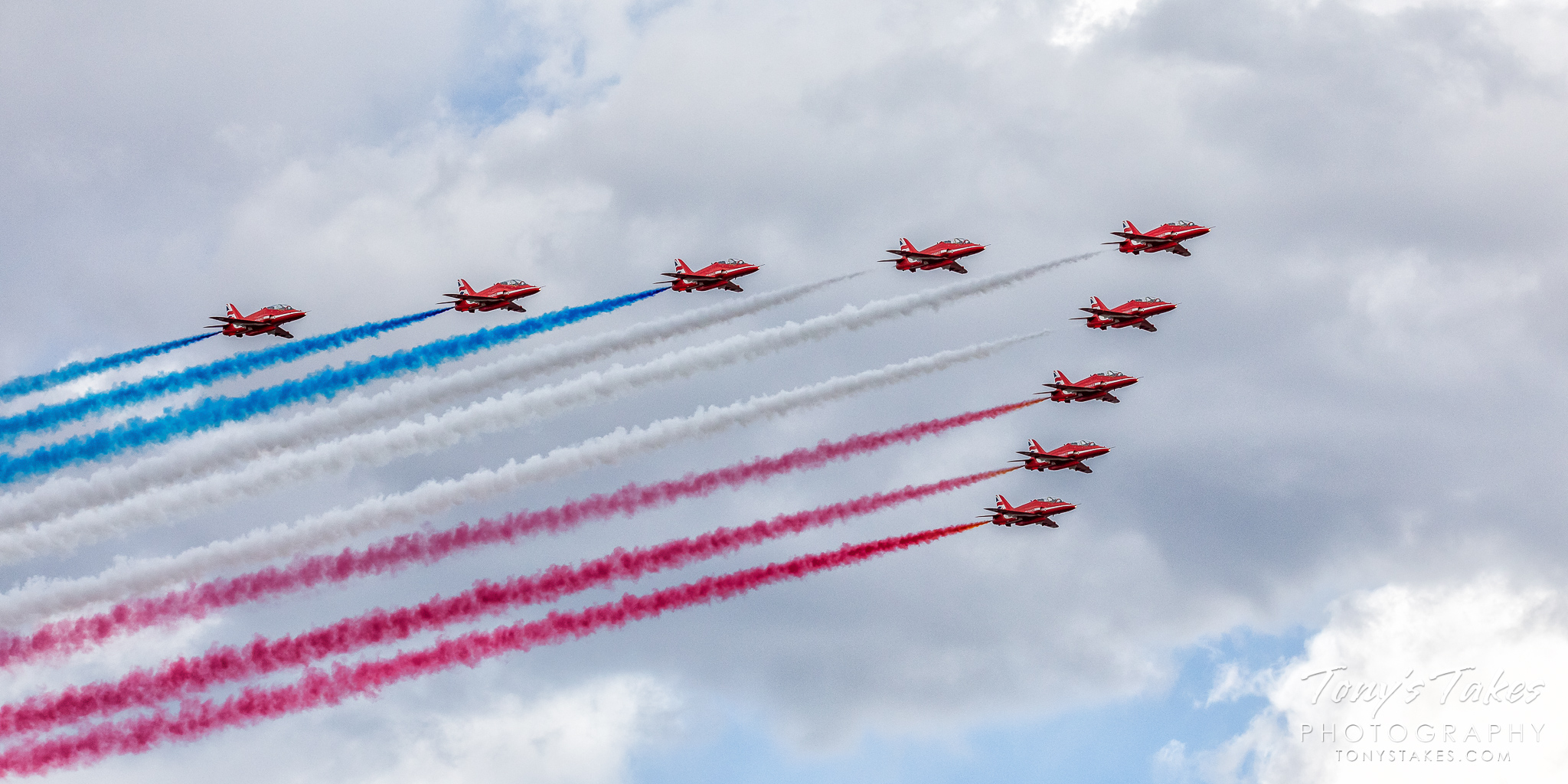 The Royal Air Force Red Arrows in formation near Denver, Colorado. (© Tony's Takes)