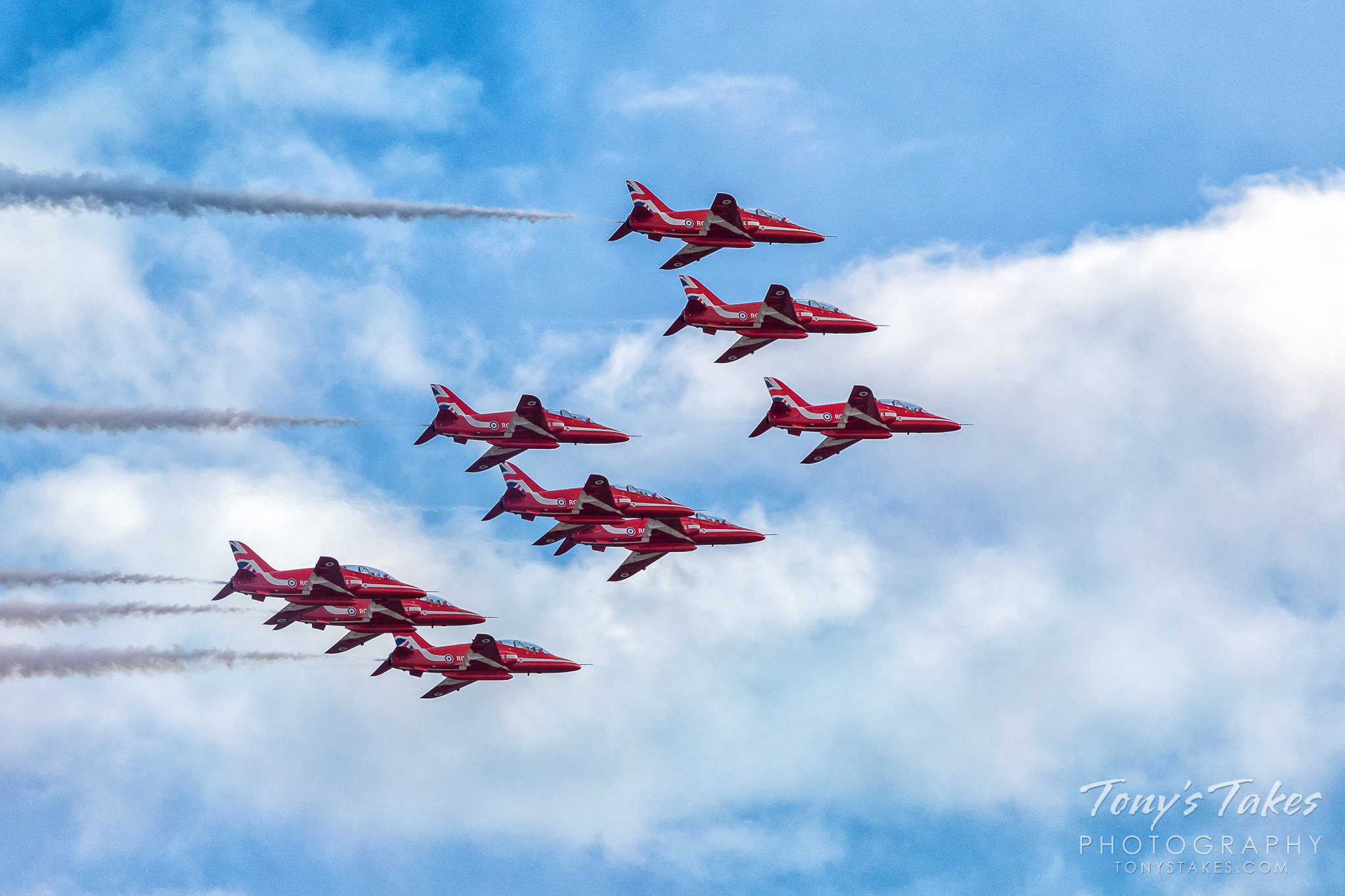 The Royal Air Force Red Arrows in formation. (© Tony's Takes)