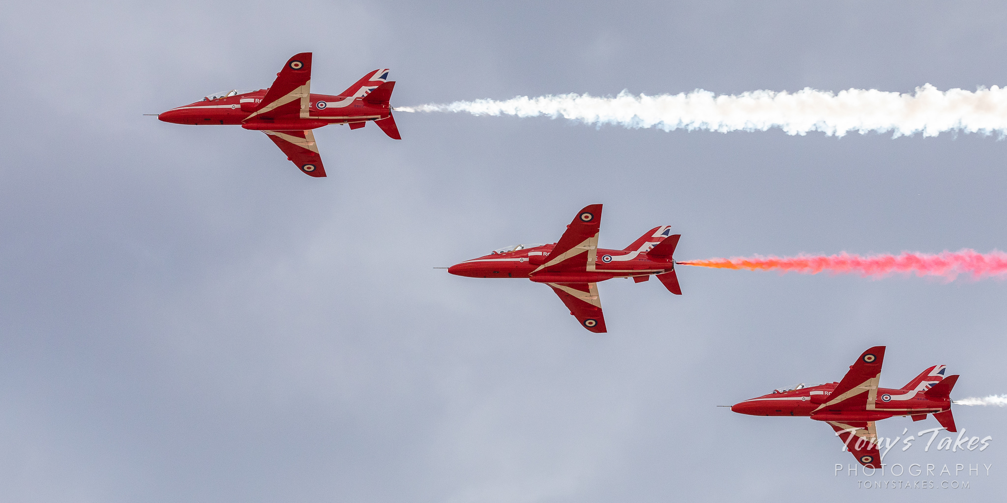 Royal Air Force Red Arrow jets fly by. (© Tony's Takes)