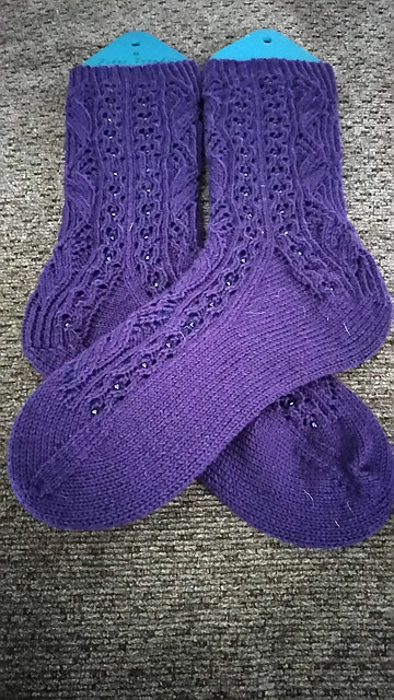 Black Tie, Optional - sock pattern by Adrienne Fong are socks livened up with beads!