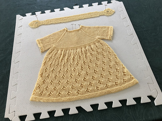 Lise has knit another variation of Taiga Hilliard's Simple & Sweet Little Baby Dress, this one using Garnstudio Drops Baby Merino.