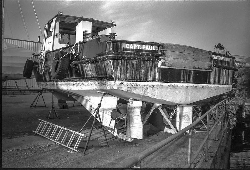 lobster boat, on stands, boatyard, ladder, railing, Rockland, Maine, Nikon SmileTaker (RF 10), Derev Pan 400, HC-110 developer, 9.7.19