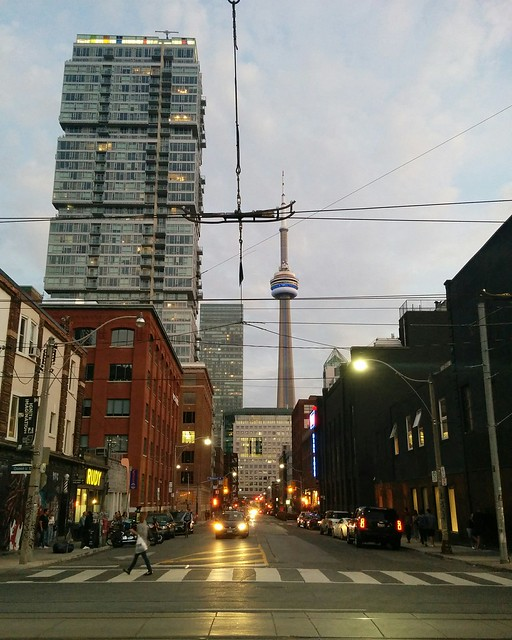 Looking south down Duncan Street at the CN Tower #toronto #queenstreetwest #skyline #cntower #duncanstreet #evening #streetcars #wires
