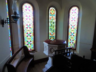 Poonindie near Port Lincoln on Eyre Peninsula. The stained glass bay window and font of St Matthews Anglican Church which was built in 1854. It was built as the school room of the Poonindie Aboriginal MIssion.