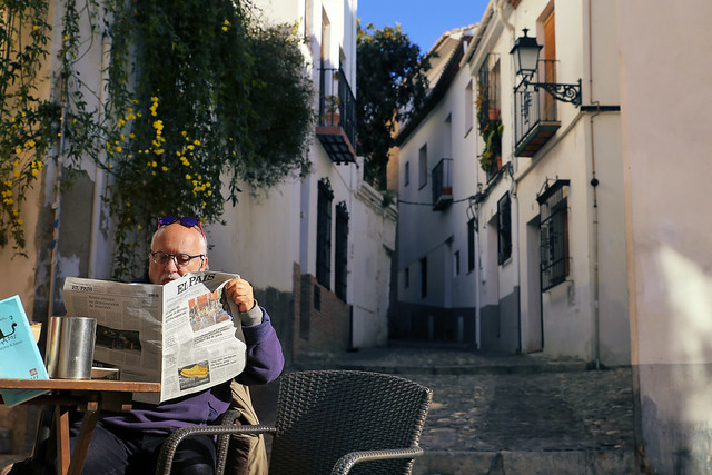 Enjoying breakfast with coffee and Spanish newspaper in Albaicín