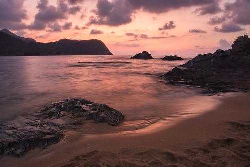 sea water sunset sand rock sky clouds nature orange