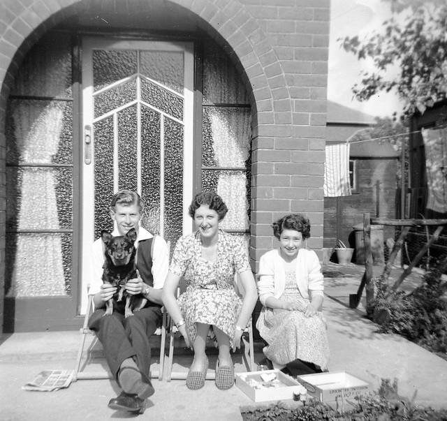 Lovely family sitting on the door step