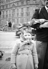 Girl with a pigeon on her head
