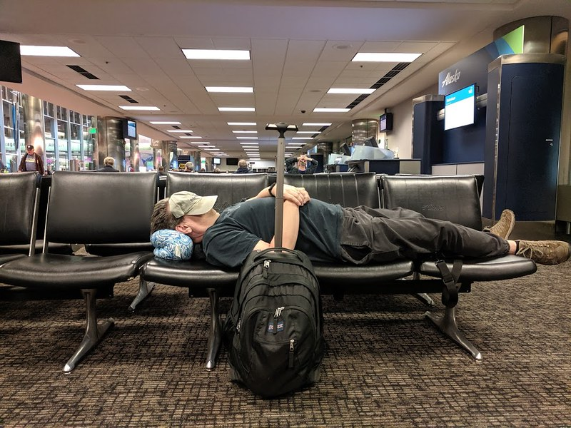 Paul sleeping at airport