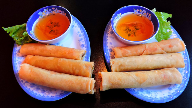 Combination pork and shrimp spring rolls, deep fried; fish sauce for dipping