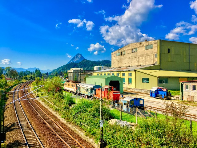Abandoned cement mill with rail yard and active railway tracks in Kiefersfelden, Bavaria, Germany