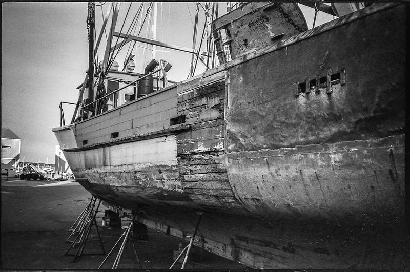 old fishing vessel, on stands, boatyard, Rockland, Maine, Nikon SmileTaker (RF 10), Derev Pan 400, HC-110 developer, 9.7.19