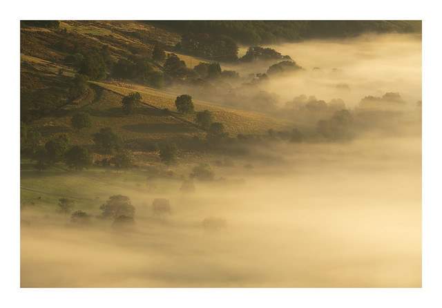 Mist lapping up the flanks of Lose Hill, Peak District UK.
