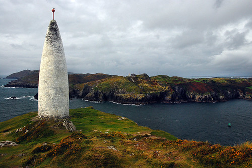 Unusual beacon on a cliff with a lighthouse on the cliff opposite in Baltimore, Ireland