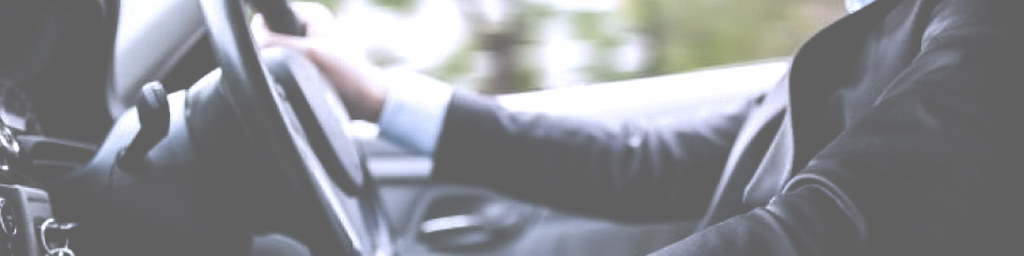 Man with his Hands on the Steering Wheel, Driving a Car