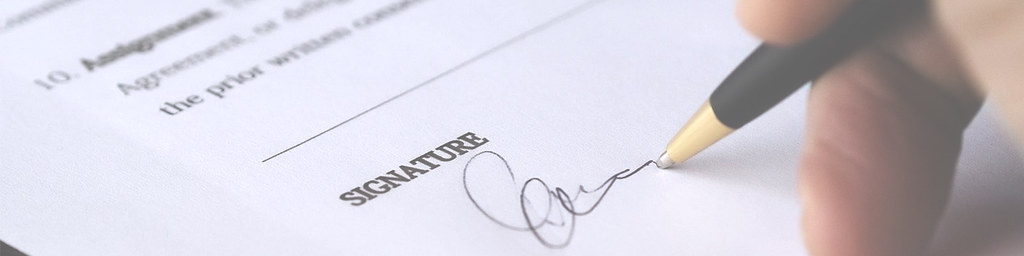 Someone Signing a Contract