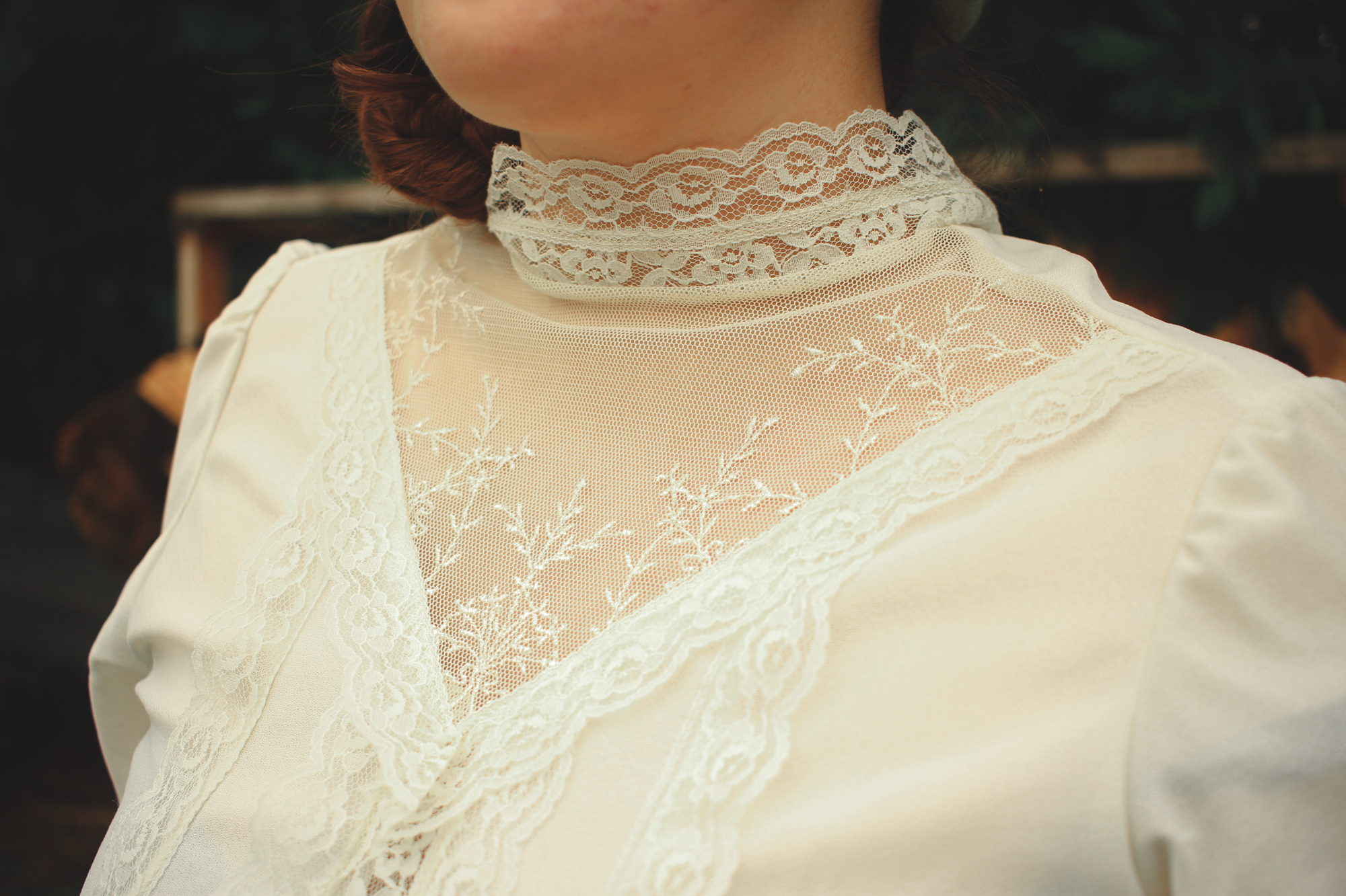 woman wearing a victorian style lace top