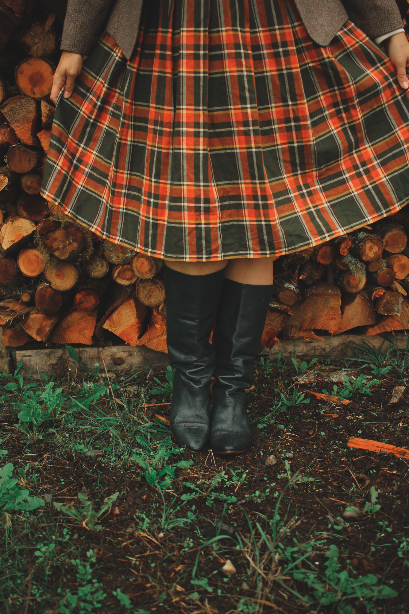 how to style leather boots and a plaid skirt