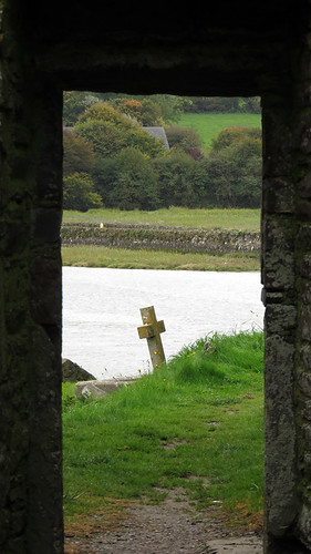 An former door leads out to the cemetery and river at the Timoleague Friary Ruins in Ireland