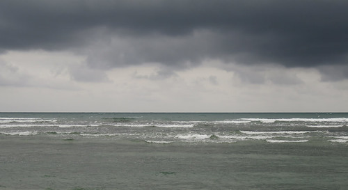 Stormy skies over the ocean on the beach after Galley Head in Ireland