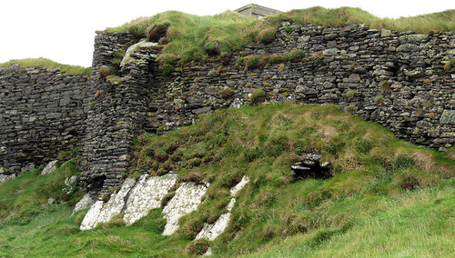 The ruins of a stone castle wall at Galley Head in Ireland