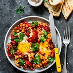 Shakshuka with baked sweet peppers and chickpeas....