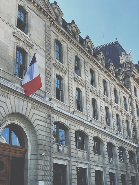 Classic Parisian architecture with France flag