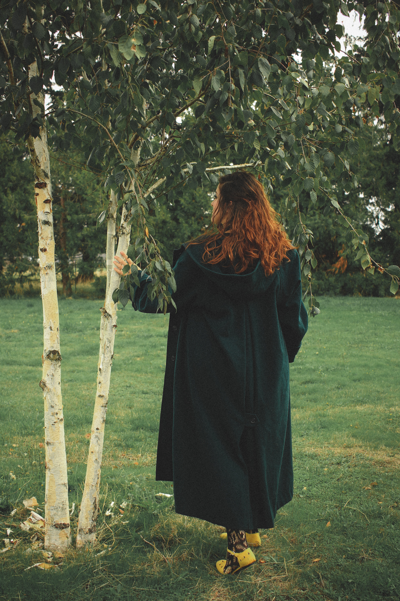 woman wearing a dark coat walking away