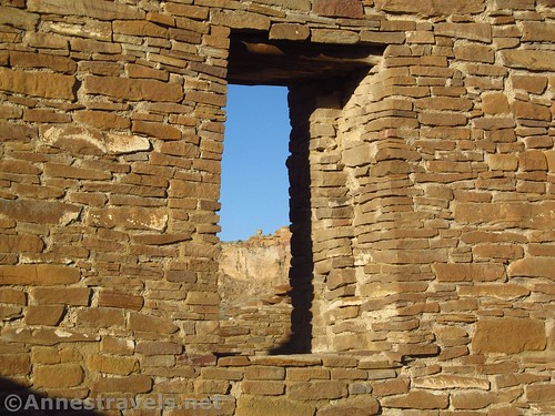 A window through the wall at Pueblo del Arroyo - with a balancing rock on the cliff beyond!  Chaco Culture National Historical Park, New Mexico