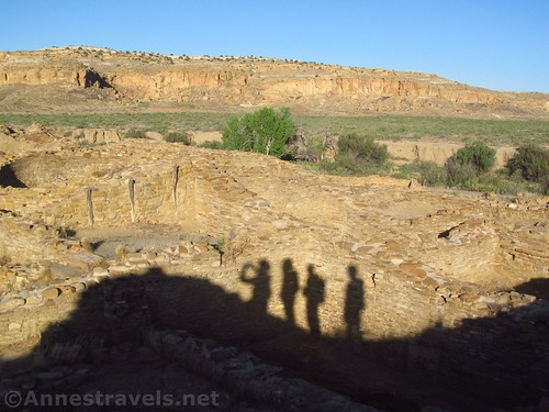 Shadows of hikers along the walls of Pueblo del Arroyo, Chaco Culture National Historical Park, New Mexico