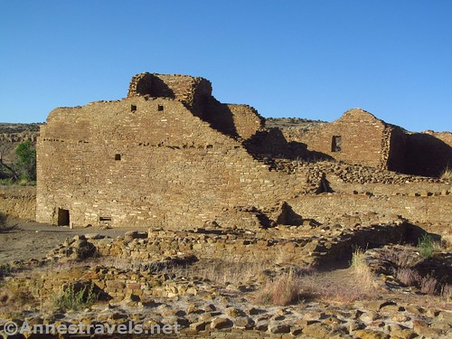 Walking around the outside of Pueblo del Arroyo, Chaco Culture National Historical Park, New Mexico