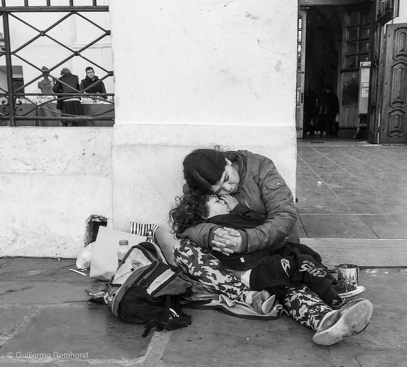 Mother and son.    A mother and her son exhausted at the Church's entrance of one of the wealthiest neighborhoods in Buenos.  #street #streetphoto #bw #argentina #buenosaires #poverty