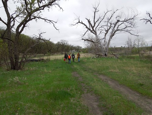 Thu, 09/26/2019 - 10:13 - The field crew walks back from a day's work censusing and mapping trees in early spring. The historic farmhouse in the background is the field crew quarters.