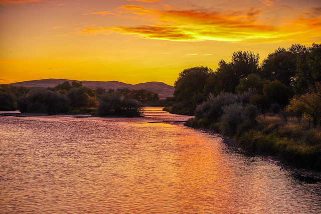 Sunset Over A River In Wyoming