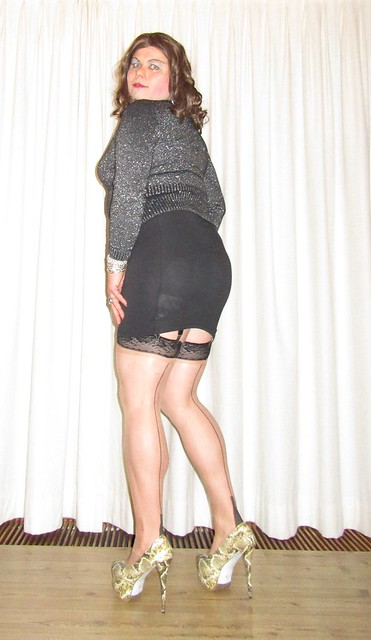 black miniskirt with stockings - view from the back