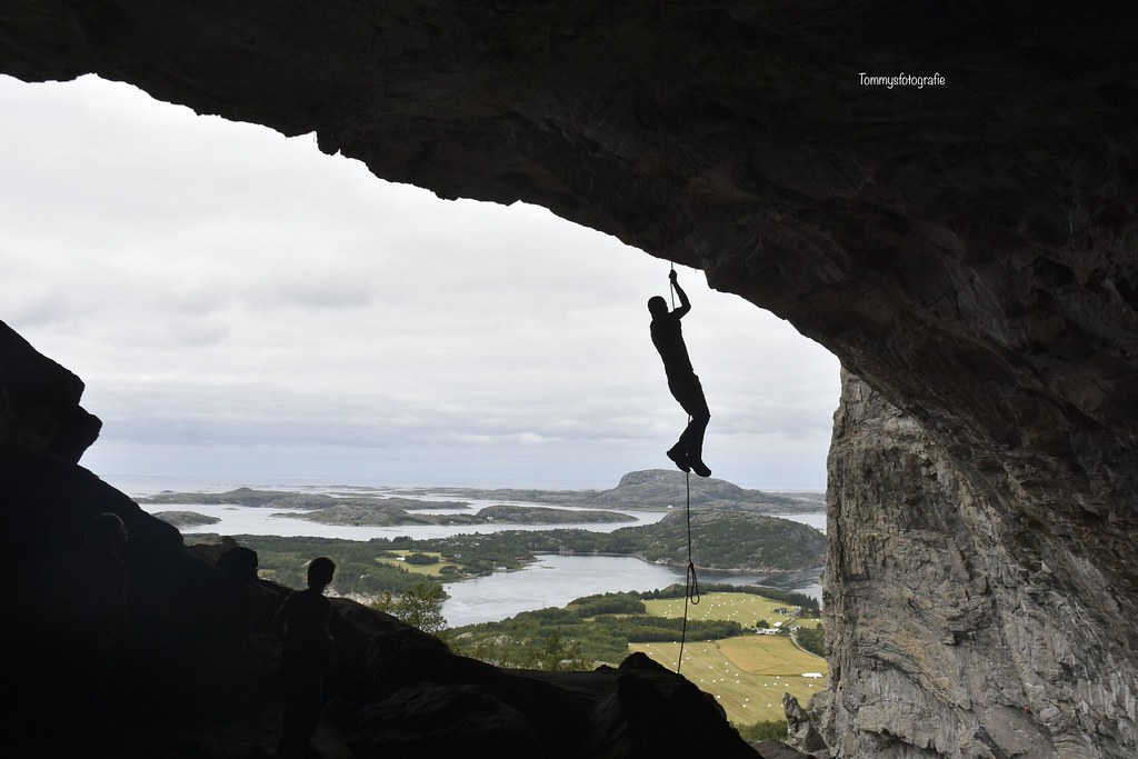 Climbing in a cave with a amazing view in Climb Flatanger in North Norway