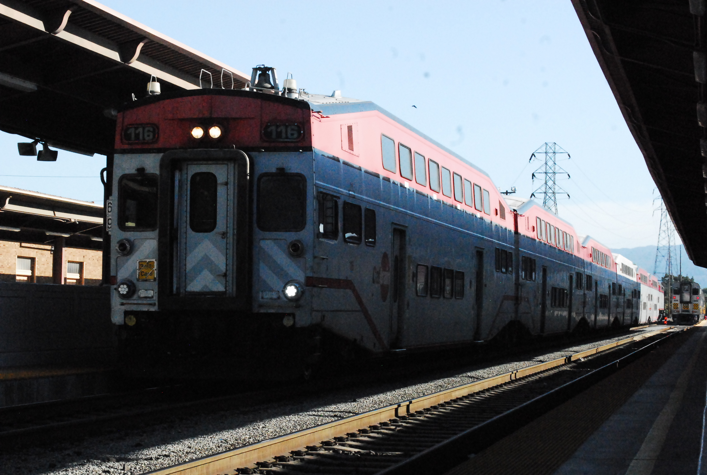 A Caltrain consist pulling in to San Jose Diridon awaiting departure to San Francisco