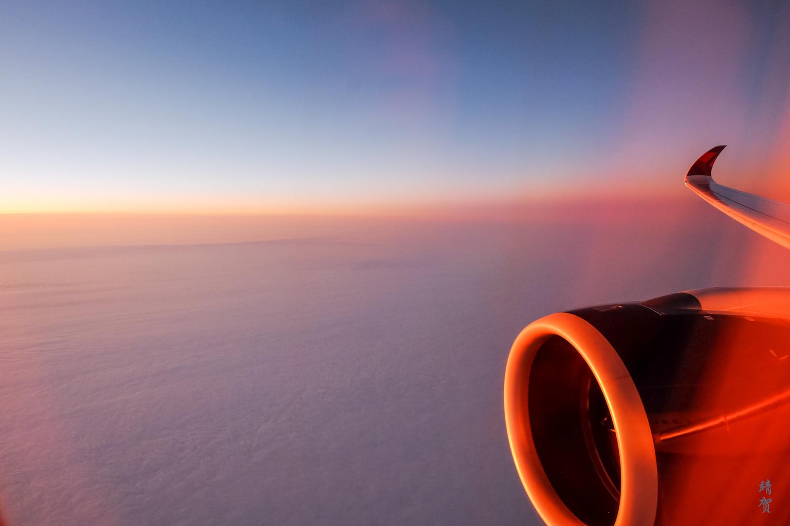 Sunrise halfway in the flight