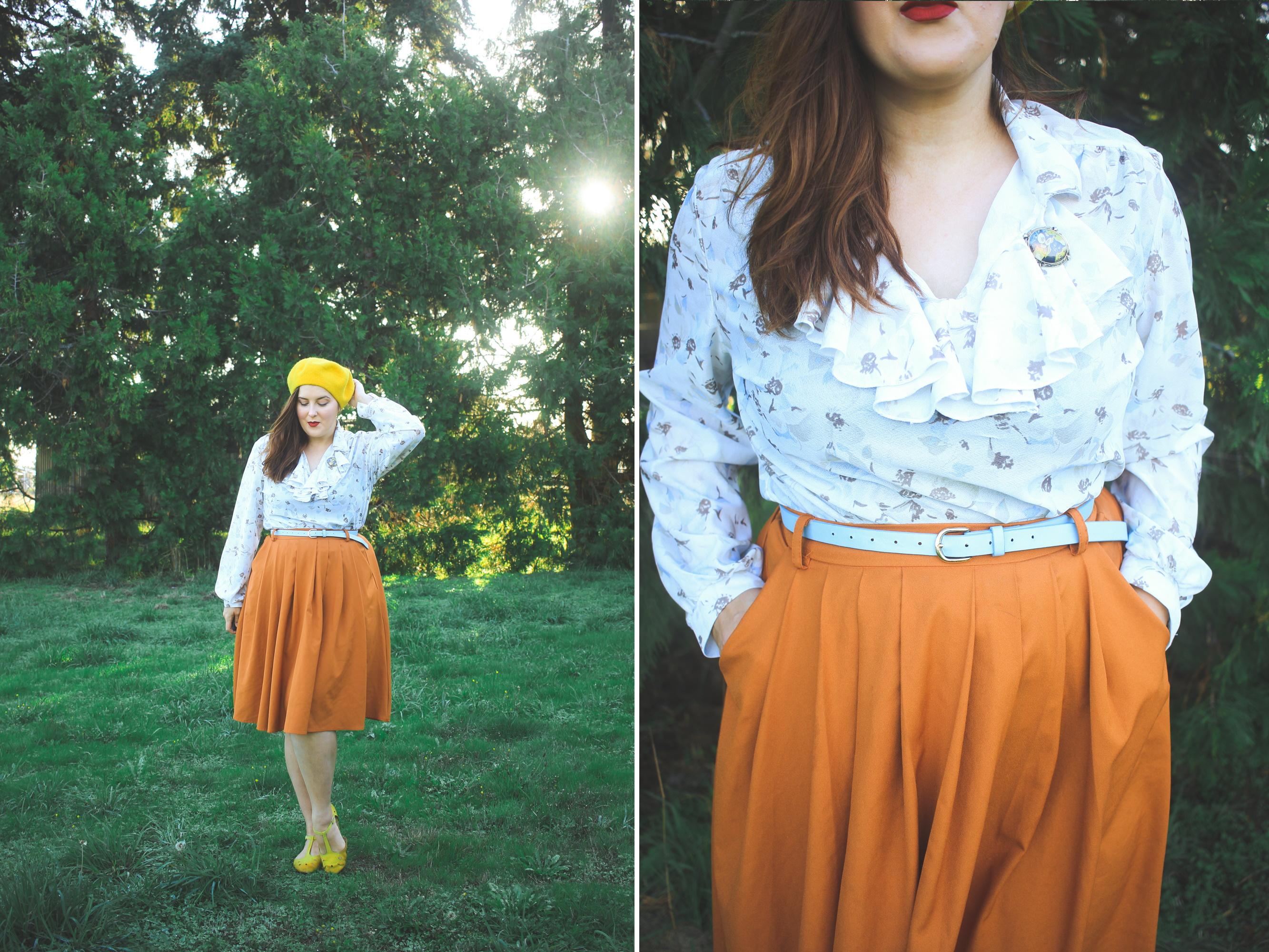 woman wearing a ruffled blouse and orange skirt