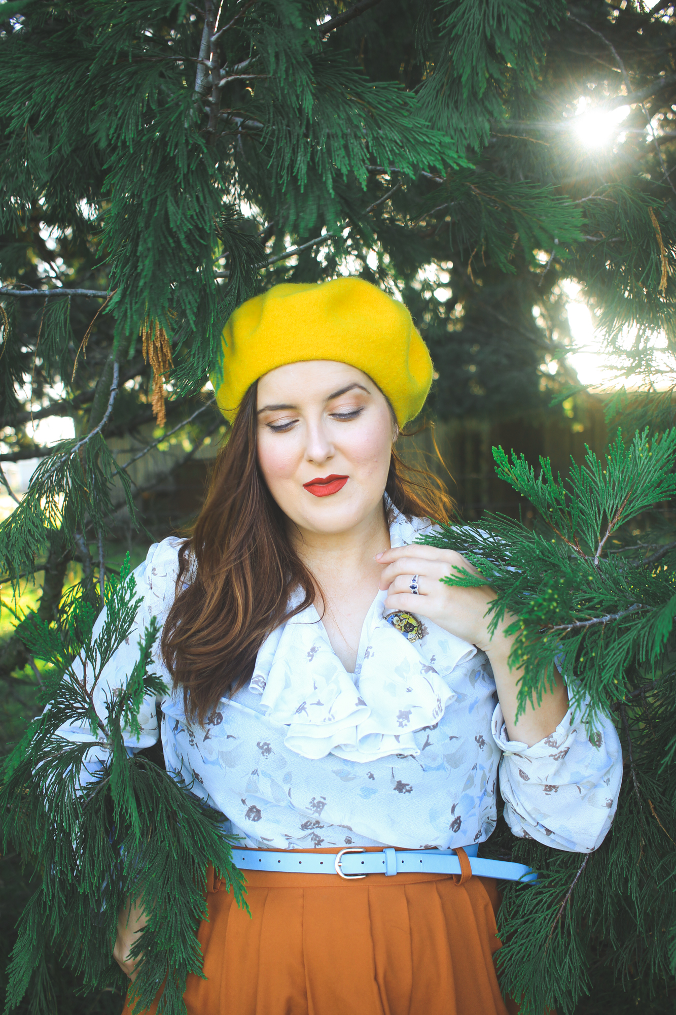 portrait of a woman in a yellow beret