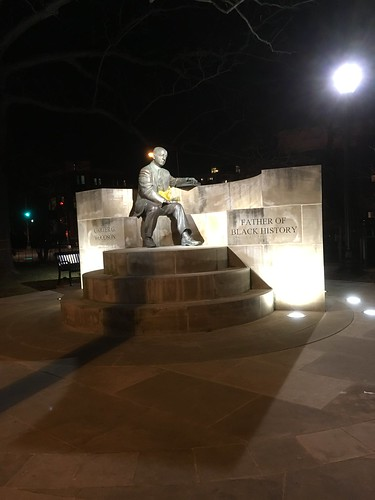 Carter G. Woodson statue at night