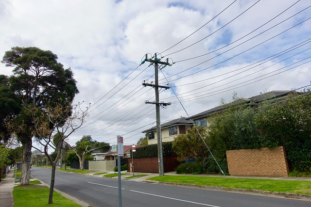 Older style Telegraph Pole with Green insulators.